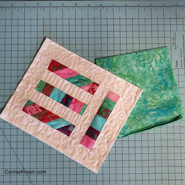 Angled Strips Mug Rug tutorial sewing machine table binding