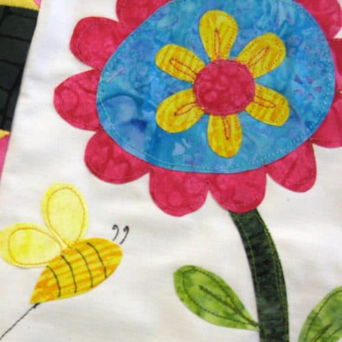 Save the Bees Block of the Month Block One closeup of the bee without black stripes