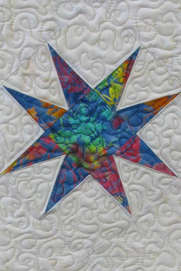 Island Batik Star tablerunner closeup of quilting