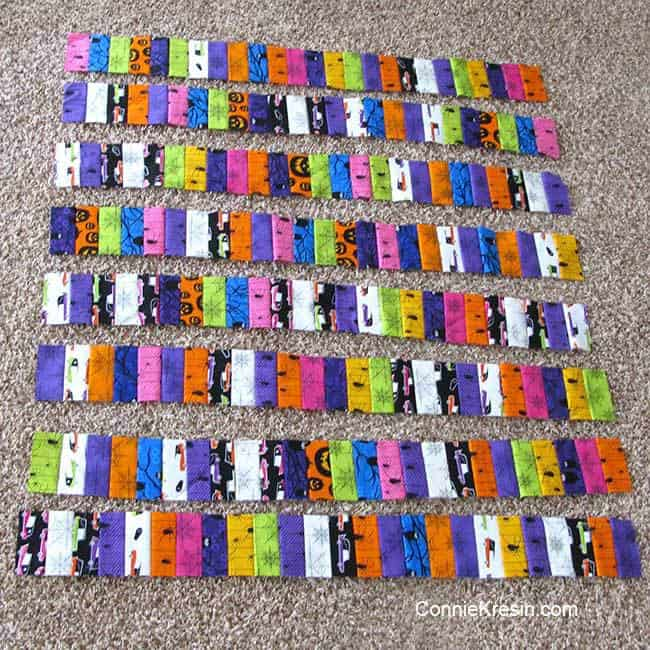 Cutting the jelly row quilt strips in half