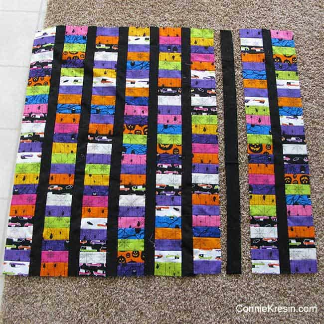 add sashing strips to the jelly roll quilt rows