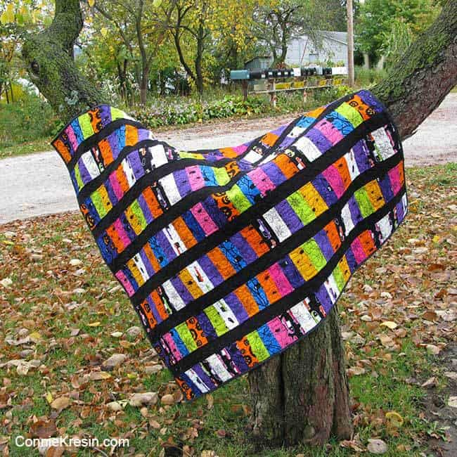 Eerie halloween quilt hanging in tree