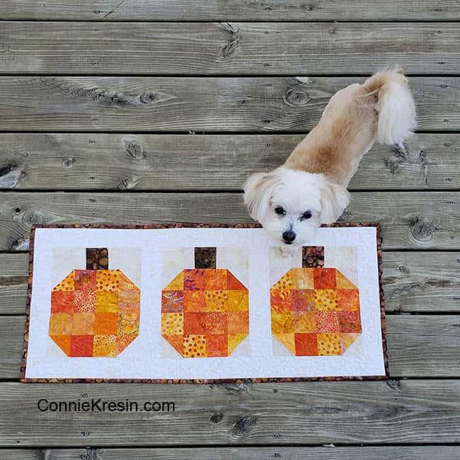 Pumpkin batik tablerunner and block tutorial with dog on deck