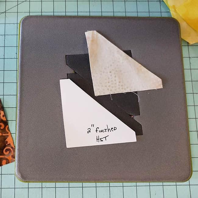 Batik Pumpkin Block tutorial scraps of quilt fabrics for half square triangles using AccuQuilt GO! die
