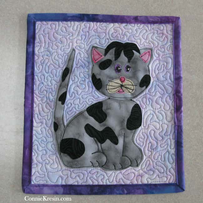 Kitty Kitty applique as a mug rug