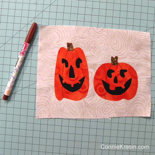 Halloween Two pumpkins mug rug marking with a permanent marking pen