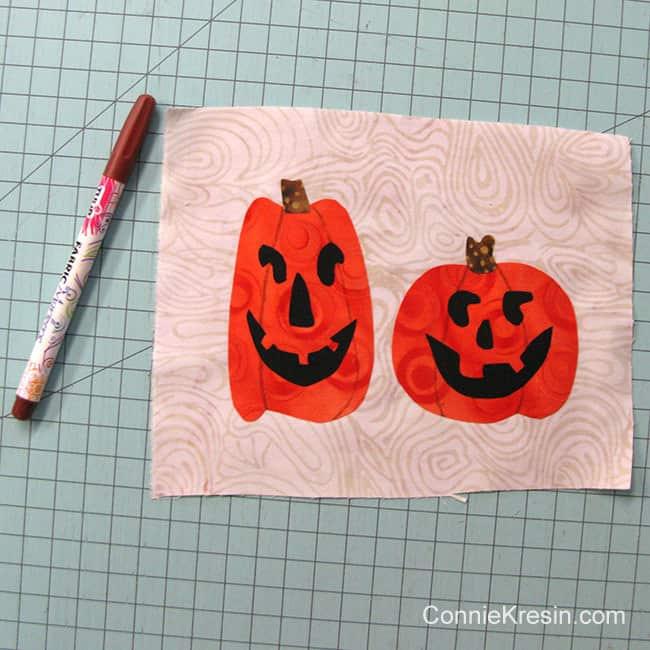 Halloween Two pumpkins mug rug marking with a permanent marking pen