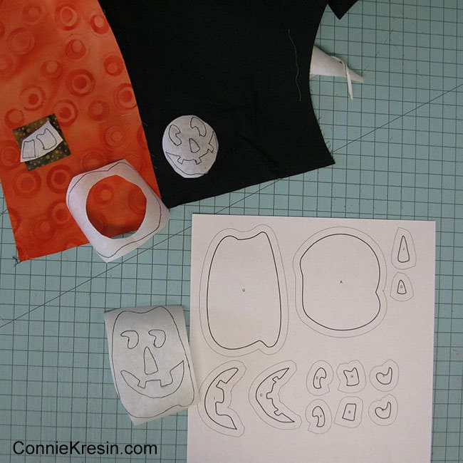 Halloween Two Pumpkins mug rug cutting the adhesive for the applique