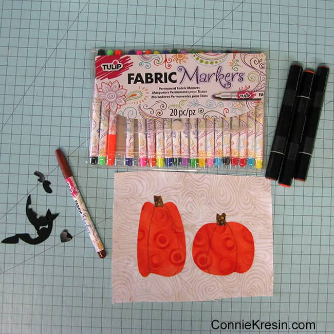 Halloween Two pumpkins mug rug marking the applique with permanent marker