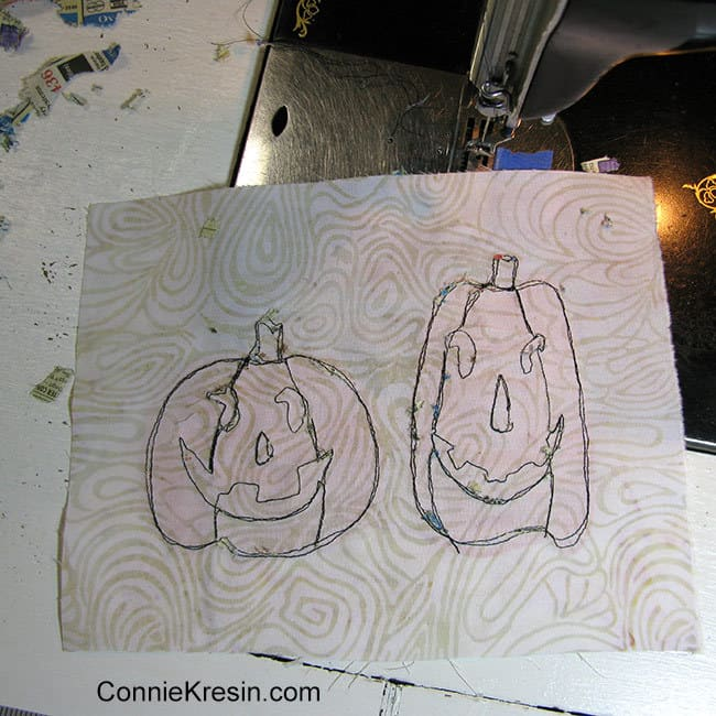 Two pumpkins mug rug using phone book paper for backing removed