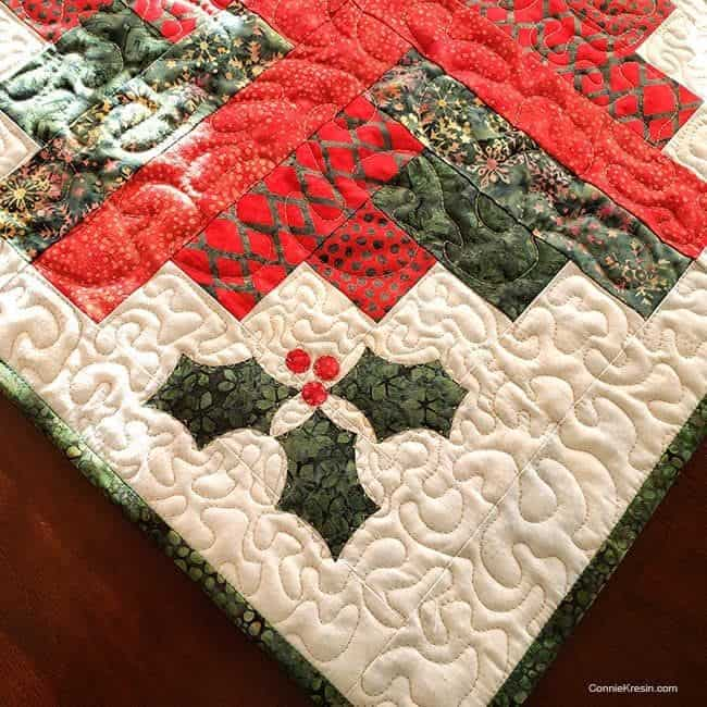 Closeup on Log Cabin quilted wall hanging