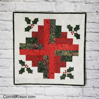 Christmas log cabin wall hanging or table topper with ivy