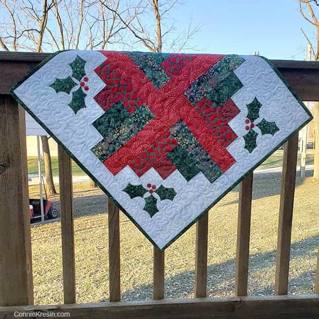Log Cabin quilt block table topper made with batiks on deck