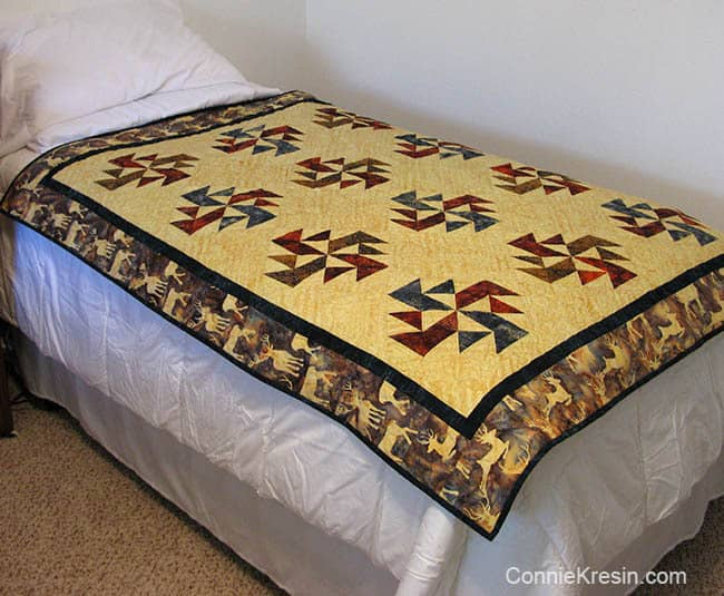 Crystal Swirls quilt on twin bed