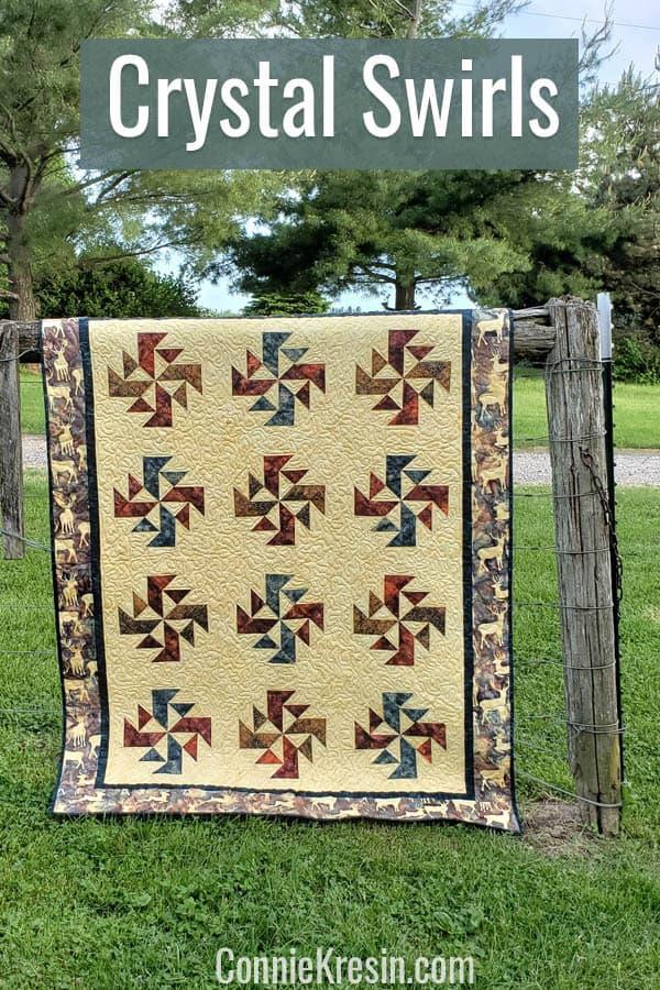 Crystal Swirls batik quilt on fence