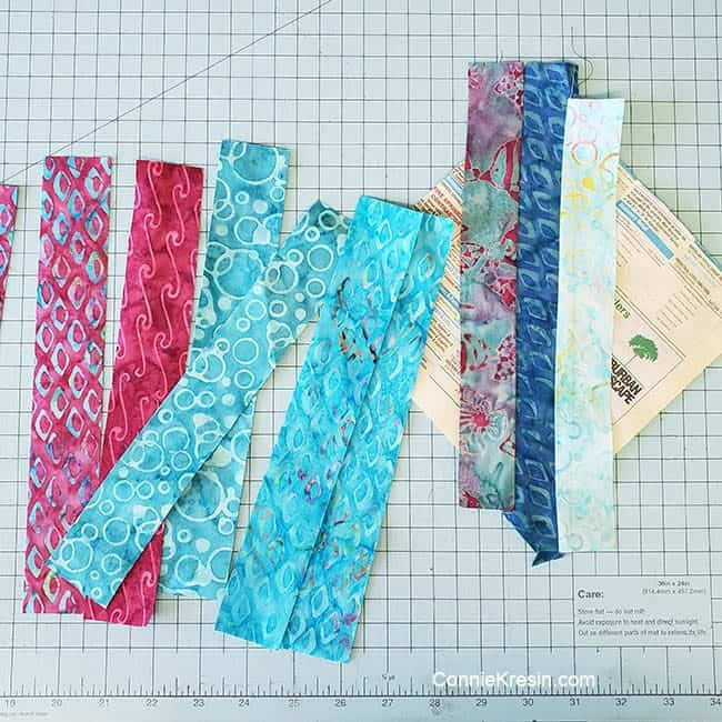 String Angles table runner made with ocean odyssey batik strips