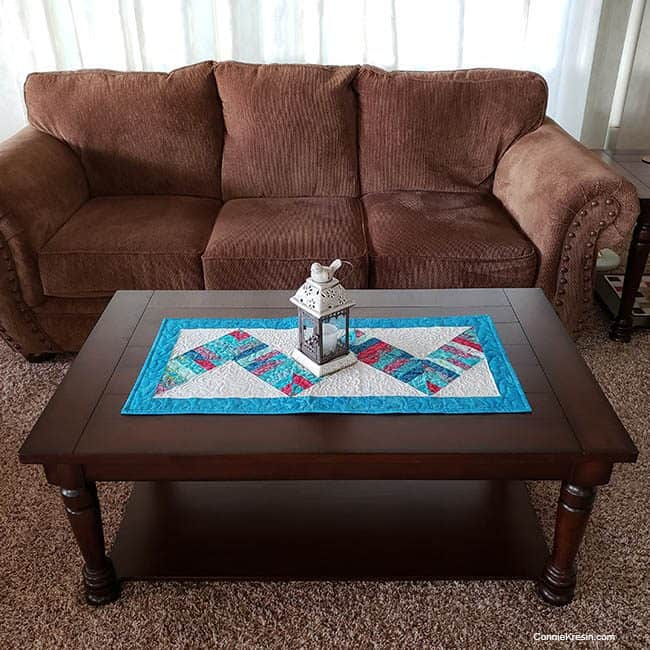 String Angles Table Runner on coffee table