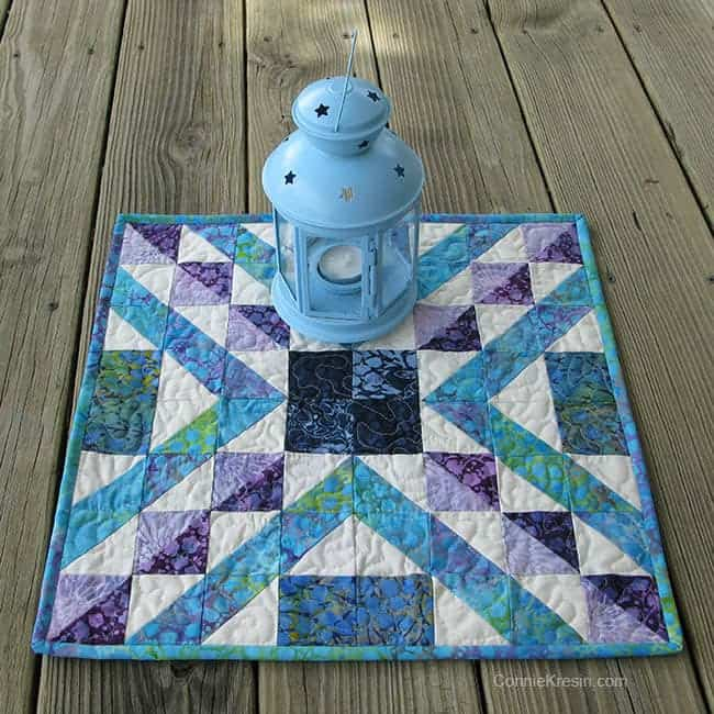 another view of the Affinity quilt block made in to a table topper on deck