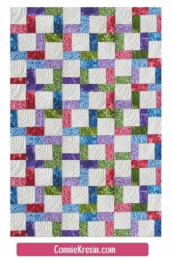 Baby quilt made from the Crossroads quilt block
