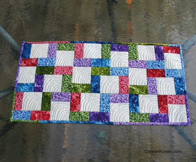 Crossroads tablerunner tutorial on glass table