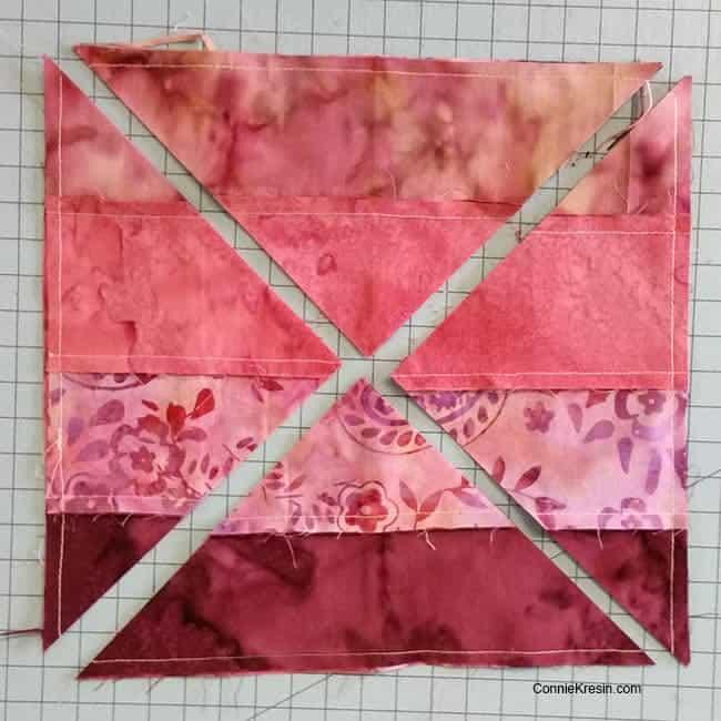 Hidden Wells batik quilt block sew strips together