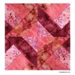 Hidden Wells completed quilt block in batiks