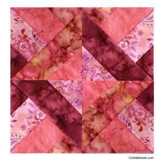 Hidden Wells completed quilt block in batiks