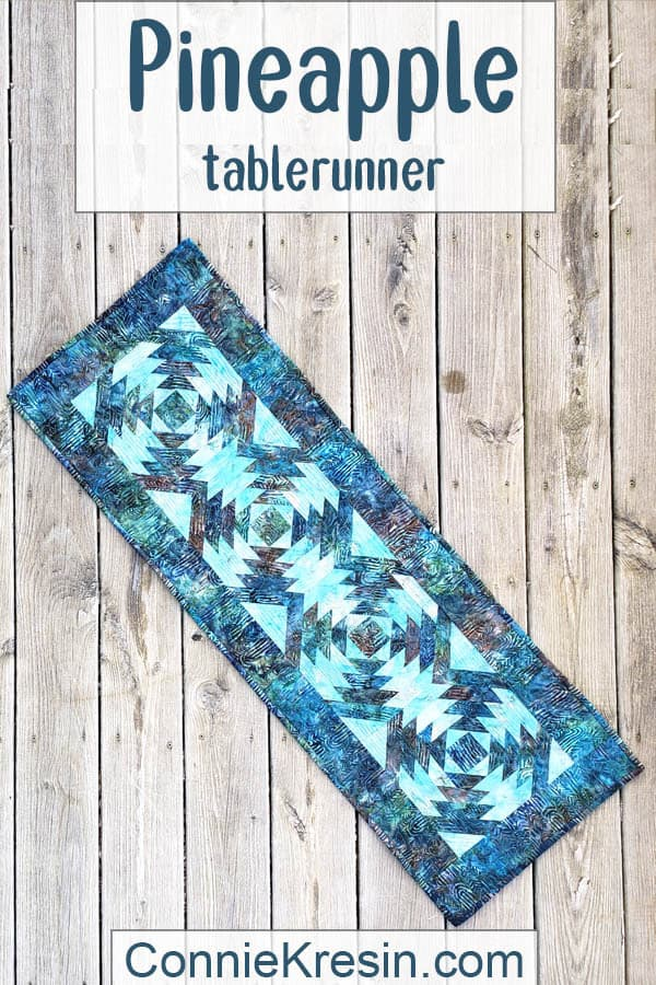 Quilted Pineapple table runner on deck