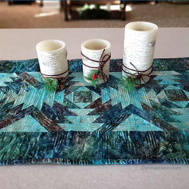 """AccuQuilt GO! 10"""" Pineapple die used to make table runner with candles"""
