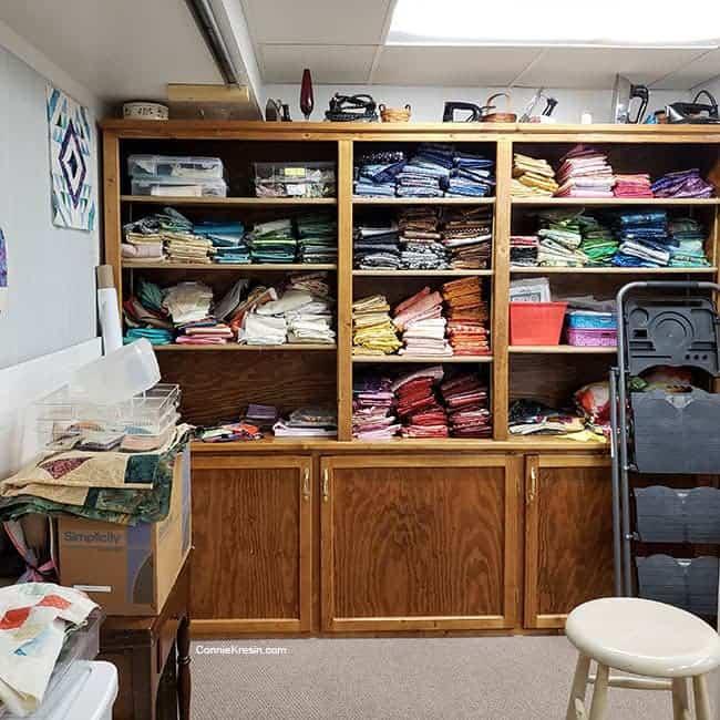 Quilt studio organizing and rearranging quilt fabrics
