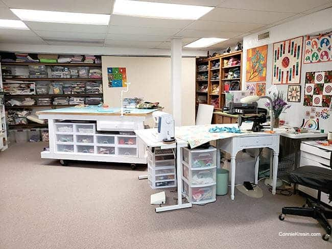 Quilt studio organizing and rearranging rolling cutting table room