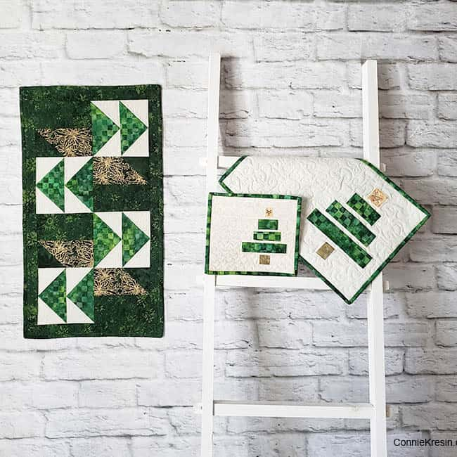 Winter Greens table runner on brick wall with ladder