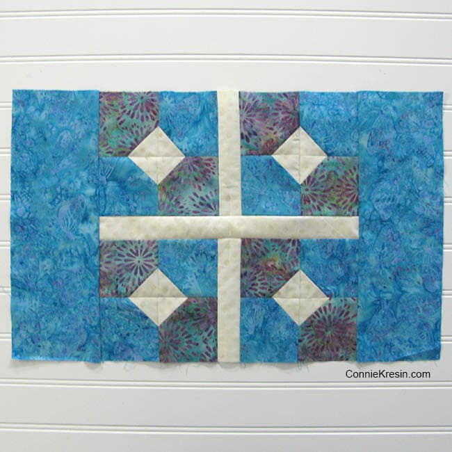 Bow tied quilt block placemat with sashing