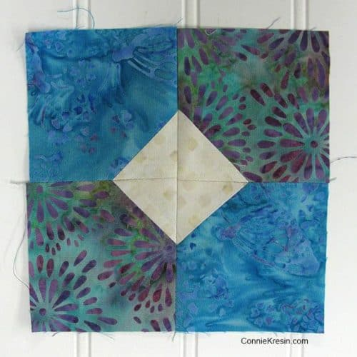 Bow Tied quilt block with four sections sewn together