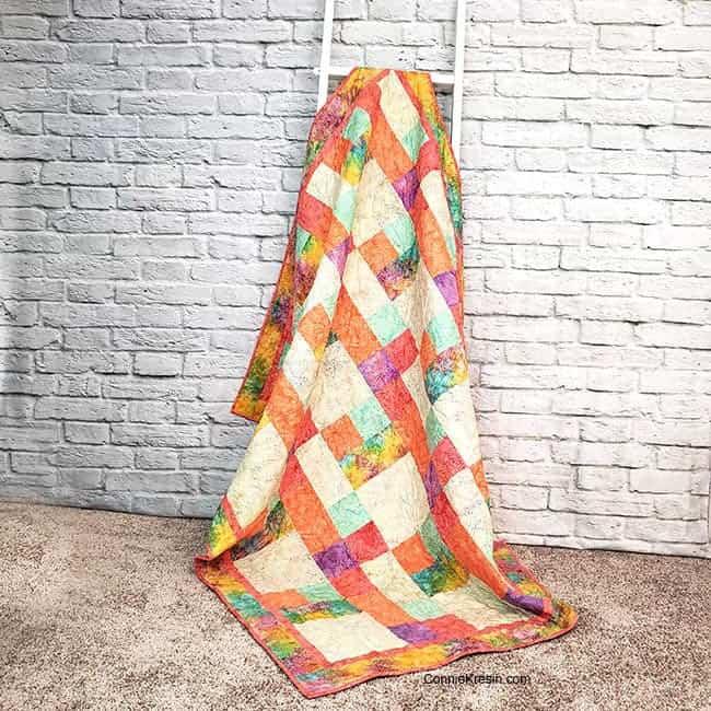 Sorbet batik quilt on ladder