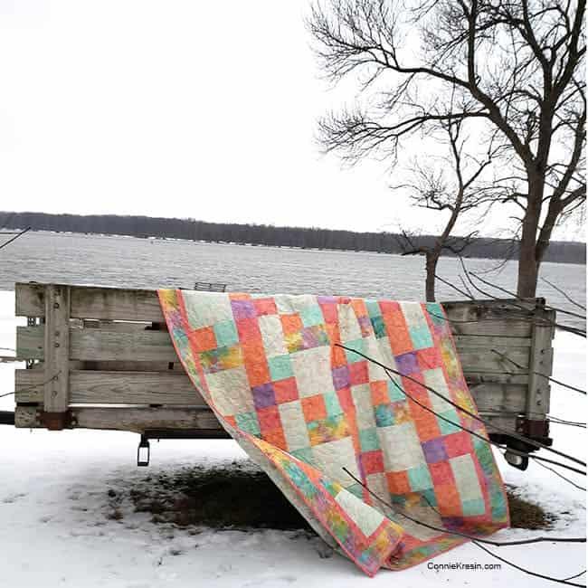 Sorbet batik quilt by the river