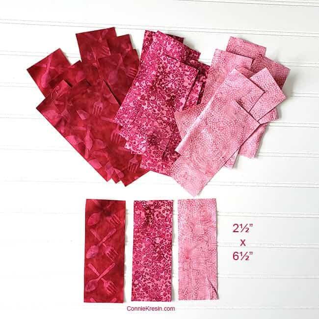Batik fabrics cut for the three by three quilt block
