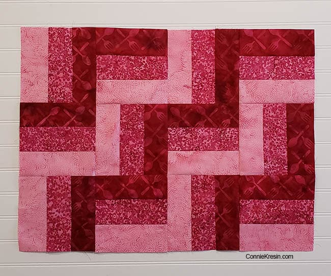 Three by Three easy table topper in pink batiks tutorial add 3