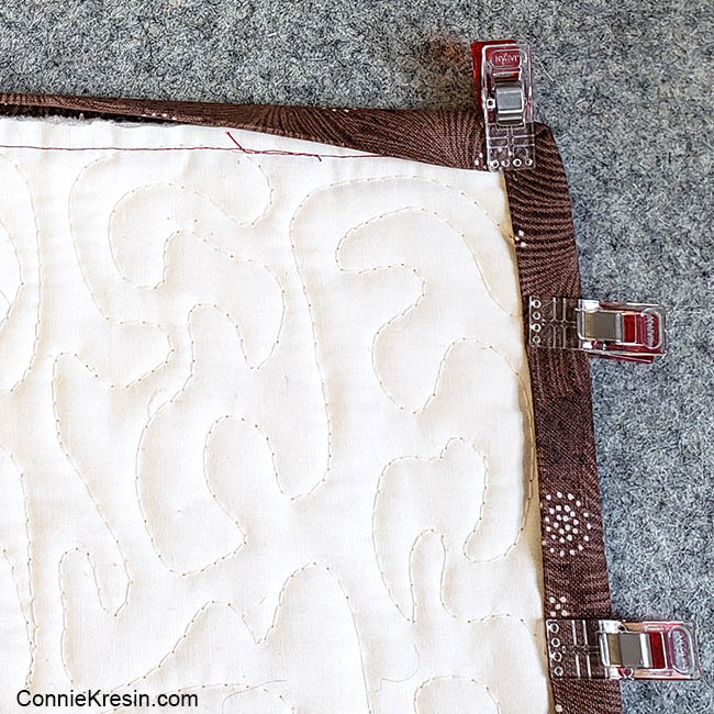 How to add binding to a quilt hold binding with clips