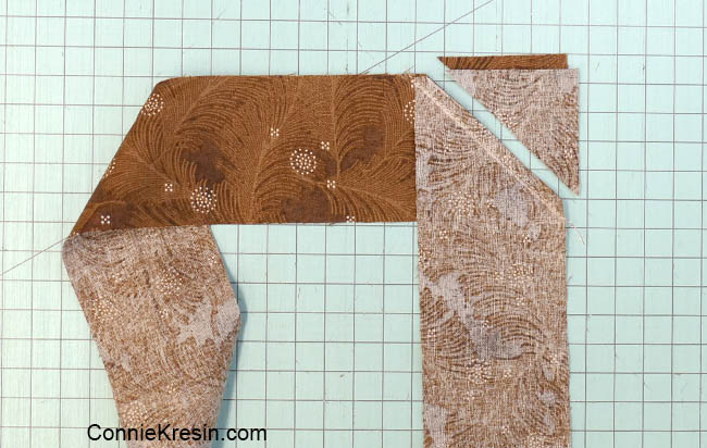 How to add binding to a quilt cutting the corner off of the binding