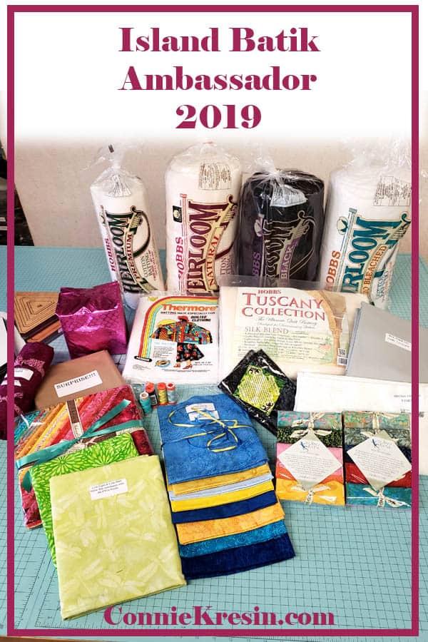 Island Batik Ambassador for 2019 receiving a box of batiks and other goodies