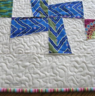 Machine binding on the River Whirls Quilt