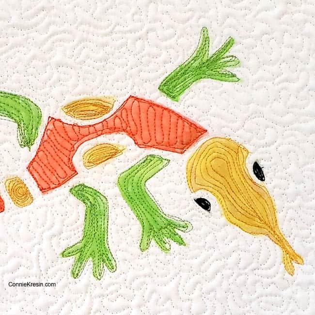 Stencil Revolution Aztec Lizard stencil on fabric closeup