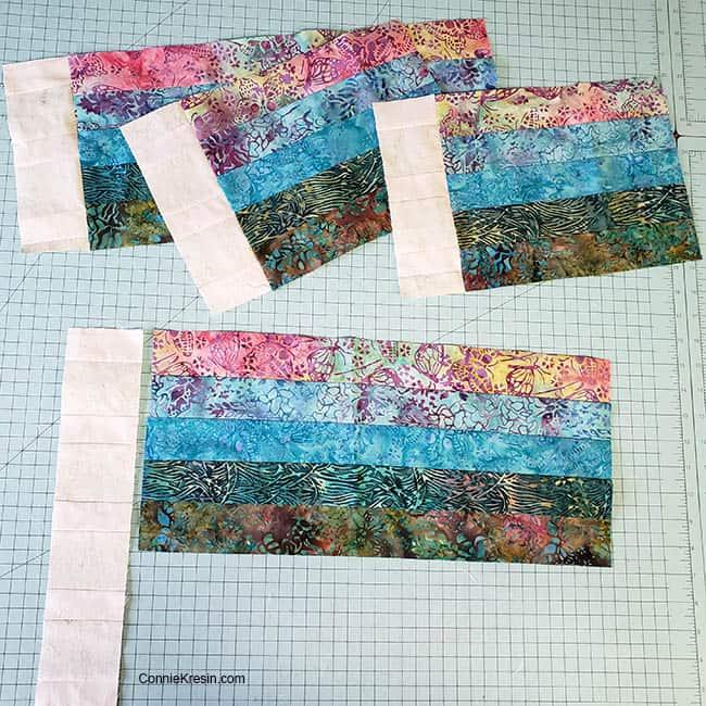 Bargello place mats made from batik scraps adding neutral strips