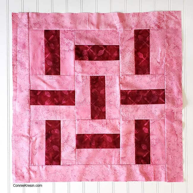 Three by Three 2 color quilt block table topper with border