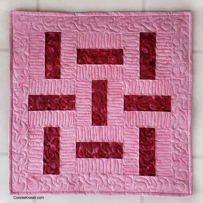 three by three quilt block table topper in just two colors quilted