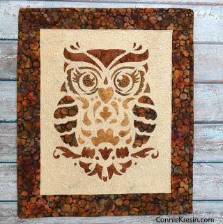Owl Stencil Quilted Wall Hanging on backdrop