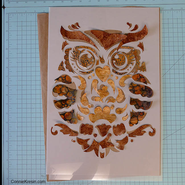 Owl Stenciled quilted wall hanging with applique pieces cut out