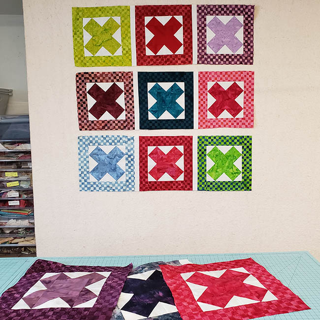 Baby Quilt made with AccuQuilt Qube die and Island Batik fabrics extra blocks