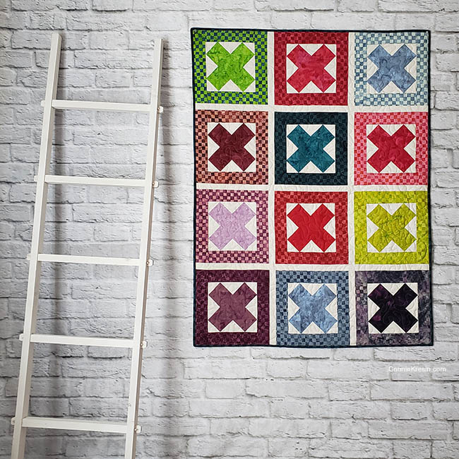 Ready Set Go Baby Quilt by a ladder